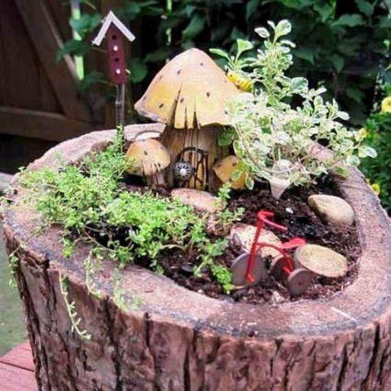23-DIY-Tree-Stump-Garden