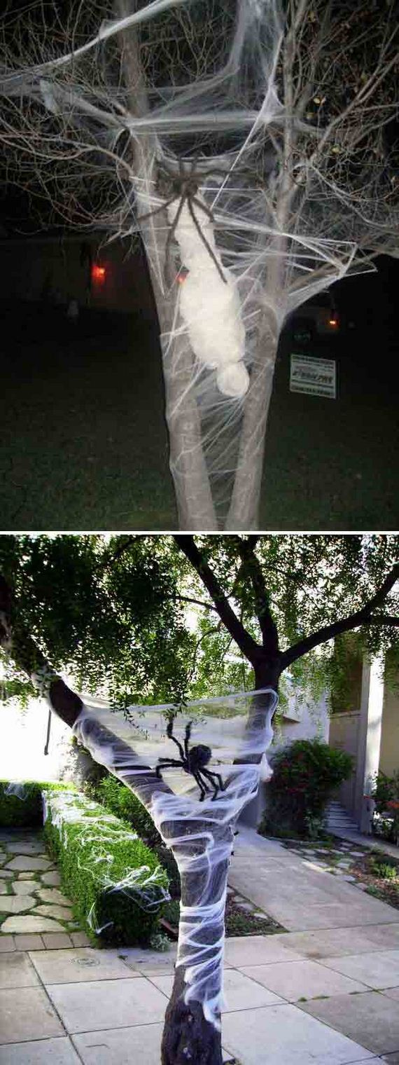 Creepy halloween outdoor trees ideas for Decorating outdoor trees
